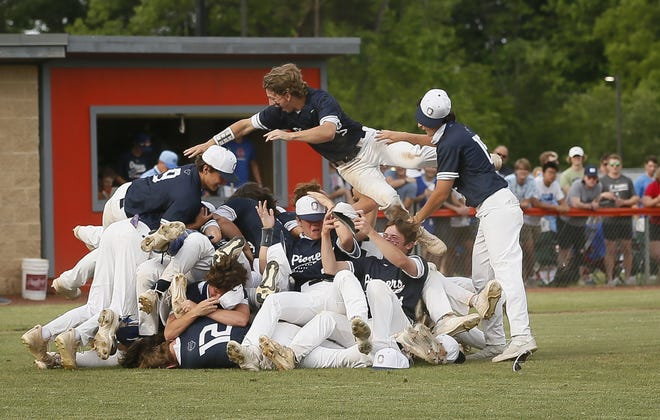 Olentangy Orange celebrates a 5-1 win over visiting Olentangy Berlin in a Division I district final May 27.