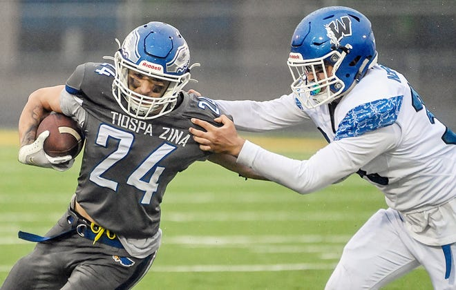 Tiospa Zina's Elijah Kawalzek (24) fights out of the grip of Winnebago's lucian DeCora during the first half of the All Nations Football Conference Championship game on Thursday at Joe Quintal Field in Mitchell.