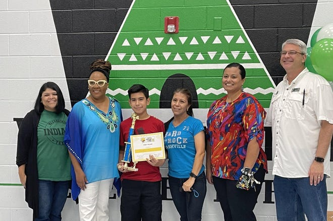 Christian Perez, a fifth-grader at Wedgeworth Elementary, holds his trophy and certificate after he won the Region 10 Spanish Spelling Bee on May 19. Christian will compete virtually in the National Spanish Spelling Bee on July 8-10.