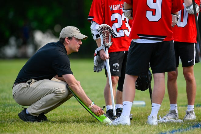Marblehead boys lacrosse coach John Wilkens talks to his players at halftime during a game versus Saugus at Stackpole Field in Saugus on Thursday, May 27.