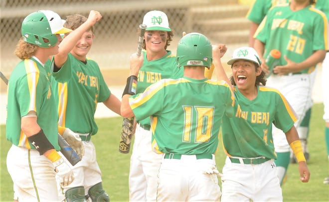 New Deal players congratulate Colby Henderson after he scored on an error the fifth inning against Albany. New Deal won the game 5-4 to sweep the Region I-2A semifinal series May 27 in Snyder.