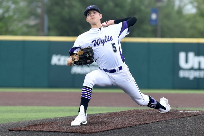 Wylie starter Dash Albus (5) delivers a pitch during Game 2 of the Region I-5A semifinal series against Aledo on May 28 at ACU's Crutcher Scott Field.