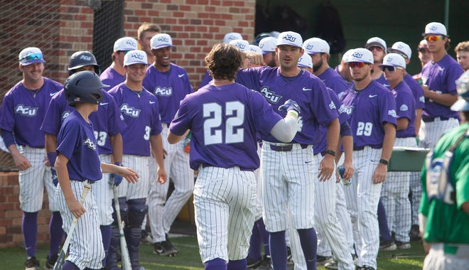 ACU players greet Grayson Tatrow (22) after he hit a solo homer to put the Wildcats up 1-0 against Texas A&M-Corpus Christi at the Southland Conference tournament Thursday, May 27, 2021 at Hammond, Louisiana. ACU won 4-3.