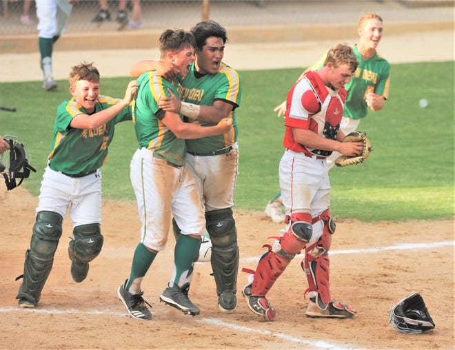 New Deal catcher Noah Rodriguez celebrates with Slade Martin, near left, after Martin scored the winning run in Game 2 of a Region I-2A semifinal series against Albany on May 27 at Moffett Field in Snyder.