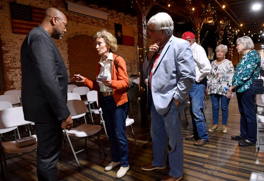 Carolyn Sandner chats with Robin Armstrong after Thursday's Taylor County Republican Party meeting.