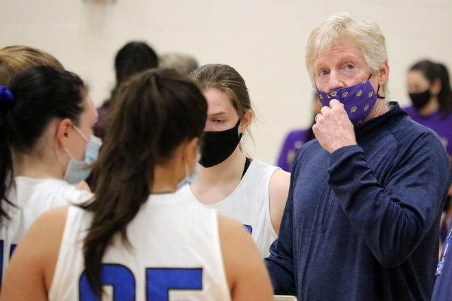 Longtime North Mason teacher and coach Brian Barker returned to led the Bulldogs' girls basketball team this season after the team's previous coach left at the beginning of the season.