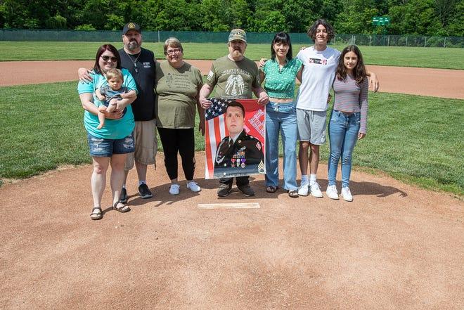(L-R) Gire family members Jessica Gire, Axeton Gire, Paul Gire III, Peggy Hunt, Paul Gire,  Jackie Gire, Nick Gire, and Riley Gire  stand on the pitchers mound of the new Huntington High School baseball field.