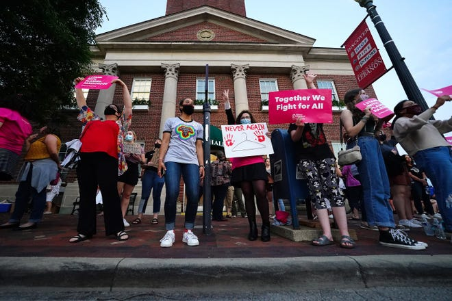 """Supporters of abortion rights protest at the town hall in Lebanon, Ohio, in May. The City Council voted to declare Lebanon a """"sanctuary city for the unborn."""" Doctors who perform an abortion in the city may now be charged with a misdemeanor."""