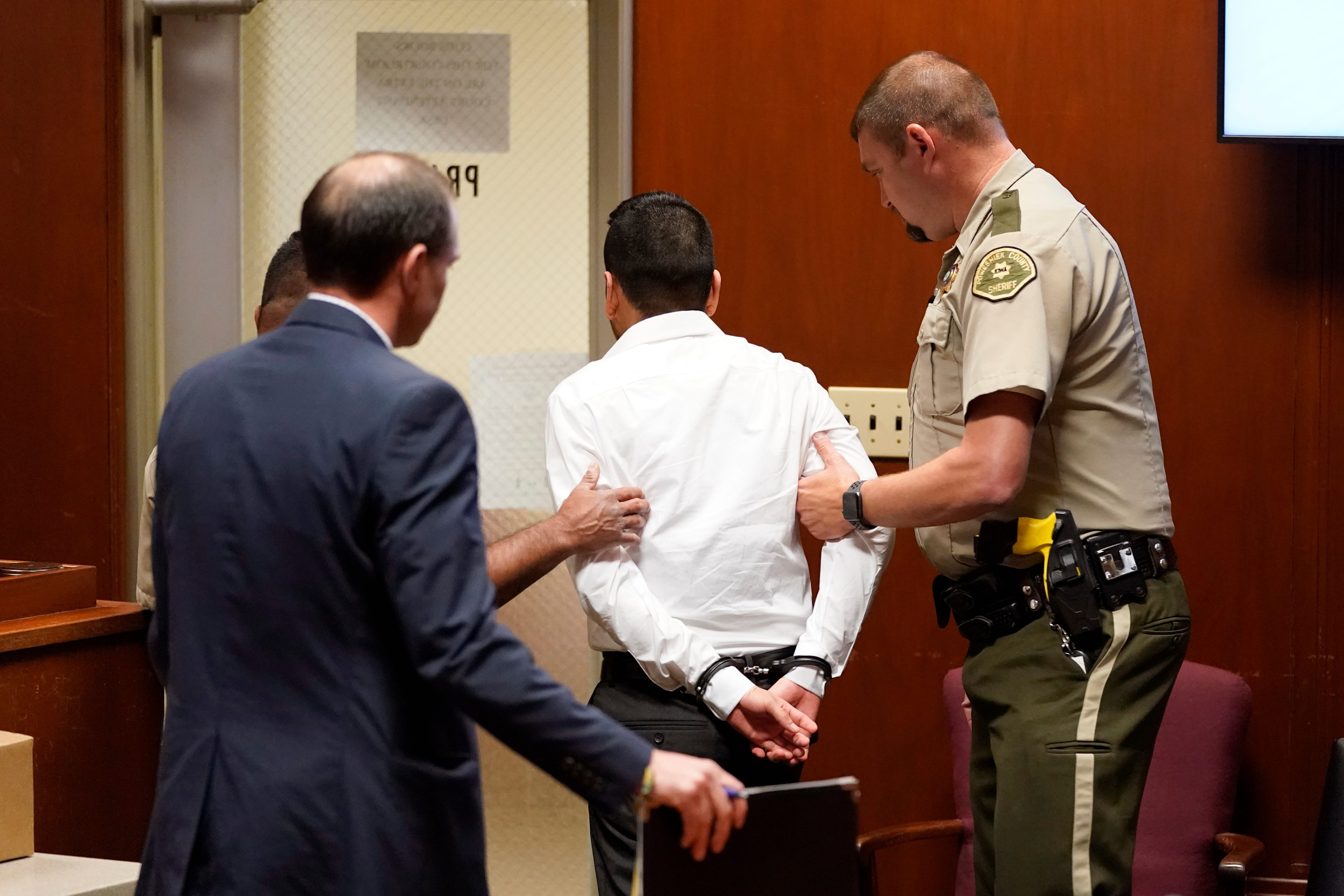 Cristhian Bahena Rivera is led out of court after a jury found him guilty of murdering Mollie Tibbetts.