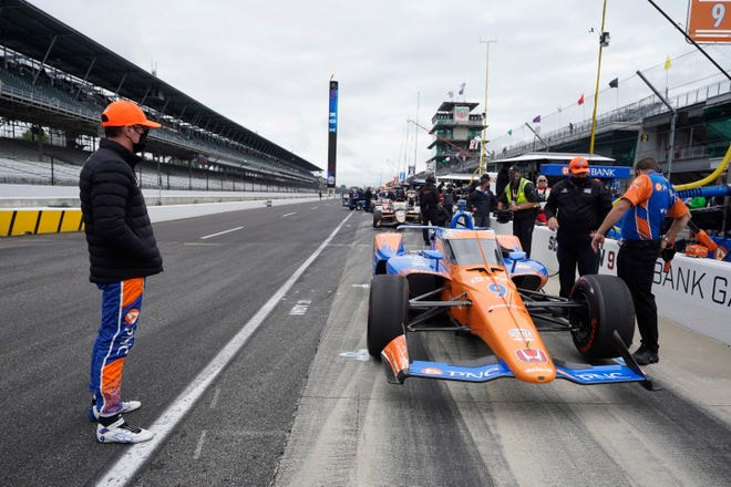 Scott Dixon, of New Zealand, stands on pit road during the final practice session for the Indianapolis 500 auto race at Indianapolis Motor Speedway, Friday, May 28, 2021, in Indianapolis.
