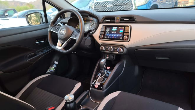 The interior of the 2021 Nissan Versa features comfortable seats for long trips, and (on the SV model and above) smartphone app connectivity and CVT tranny.