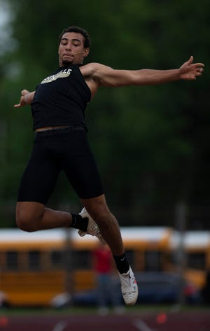 Boonville's Devin Mockobee, shown in the Central Regional, won the state long jump with a leap of 23 feet, 33/4 inches on Friday at Ben Davis High School in Indianapolis.