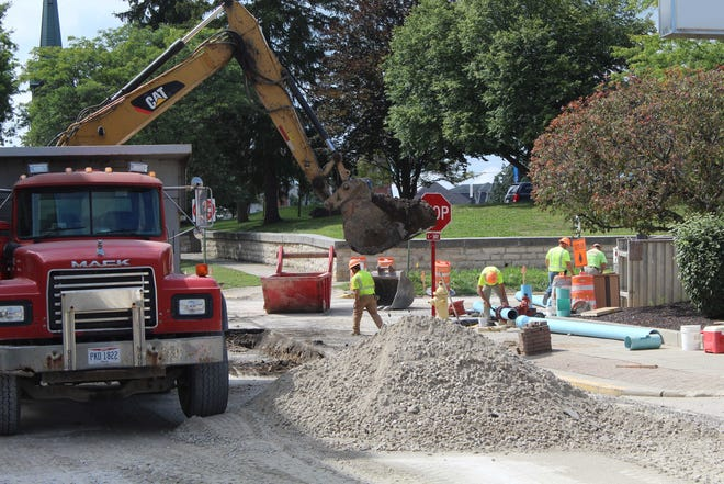 Contractors  on the city's Garrison Street project were seen here working at the intersection of Garrison and Arch Streets in 2019. Fremont City Council is considering a new  five-year,.5% levy to fund road remediation projects in the city.