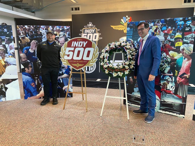 Indianapolis 500 logo designed Joel Wittman is joined by IMS president Doug Boles at the unveiling of the 2022 logo on Friday, May 28.