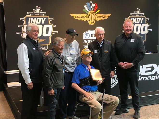 Bob Jenkins holding his Robin Miller Award on Friday, May 28. From left to right: Mark Miles, Mario Andretti, Robin Miller, Bob Jenkins, Roger Penske and Jay Frye.