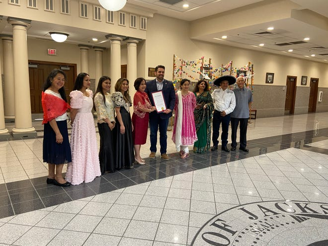 Jackson Mayor Scott Conger, Dr. Sandra Dee and a number of supports of Asian-American and Native Hawaiian/Pacific Islander Heritage Month take a photo after a reading of a proclamation at City Hall on May 28, 2021.
