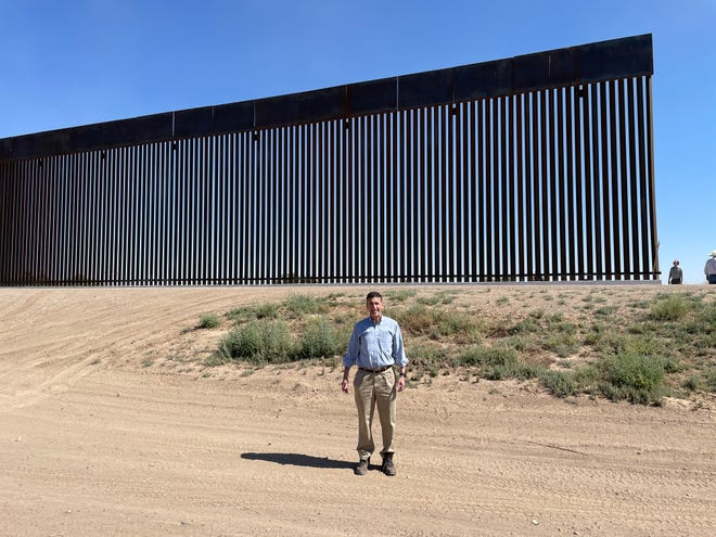 Congressman David Kustoff stands in front of a border wall that ends where construction stopped when former President Donald Trump left office for President Joe Biden.