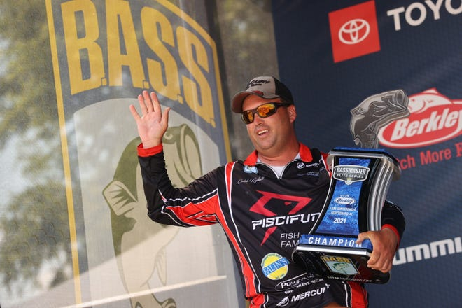 Caleb Kuphall of Mukwonago waves to the crowd May 23 after winning the Bassmaster Elite tournament on Lake Guntersville in Alabama. Kuphall became the first Wisconsin resident to win a top-level Bassmaster event in the organization's 54-year history.