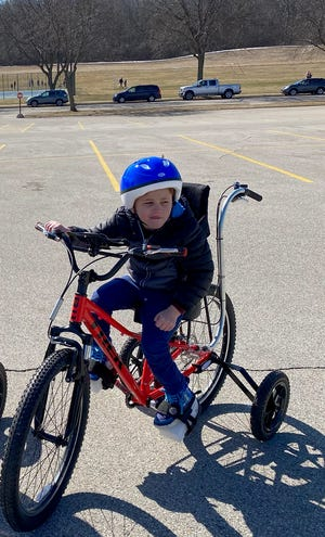 Greyson Higelmire, 5, ridesan adaptive bicycle. Through a partnership with Emerys Cycling, Triathlon & Fitness Variety – the Children's Charity of Wisconsin, children with disabilities can get funding for adaptive bicycles.