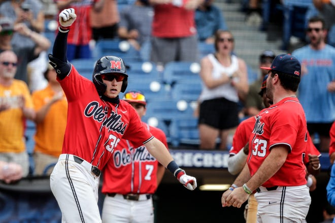 Mississippi's Kevin Graham (35) celebrates after hitting a home run against Vanderbilt in the eighth inning of an NCAA college baseball game during the Southeastern Conference tournament Friday, May 28, 2021, in Hoover, Ala. (AP Photo/Butch Dill)