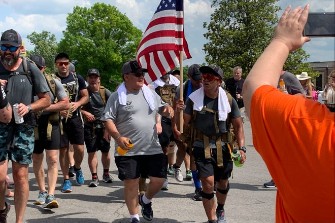 Members of the Shepherd's Men finish their 15 mile march in Lebanon, Tennessee, Thursday, May 27, 2021.
