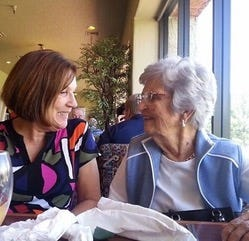 Ann Hodgins and her mother, Mary Challas, share a moment in May 2016 at a favorite family haunt, Painted Mountain Golf Course restaurant in Mesa.