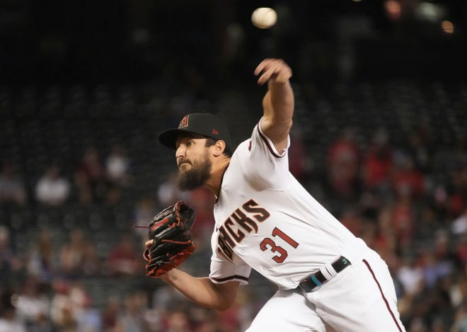 Arizona Diamondbacks pitcher Caleb Smith throws against the St. Louis Cardinals in the fifth inning during a baseball game, Thursday, May 27, 2021, in Phoenix. (AP Photo/Rick Scuteri)