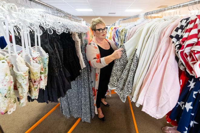 Laura Lyon, owner of Papaya Branch Boutique, sorts through inventory Friday, May 28, 2021, at Papaya Branch Boutique in Marysville. The store recently moved to Marysville from its downtown Port Huron location.