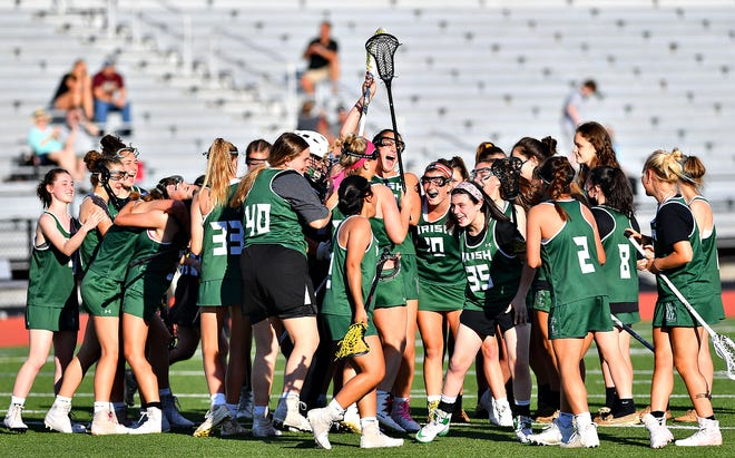 York Catholic celebrates a 14-8 win over Twin Valley during PIAA District 3, Class 2-A girls' lacrosse championship action on Landis Field at Speed Ebersole Stadium at Central Dauphin Middle School in Harrisburg, Thursday, May 27, 2021. Dawn J. Sagert photo