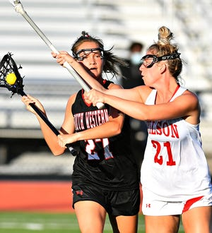 South Western's Savannah Long, left, looks to get the ball past Wilson's Lindsey Fox during PIAA District 3, Class 3-A girls' lacrosse championship action on Landis Field at Speed Ebersole Stadium at Central Dauphin Middle School in Harrisburg, Thursday, May 27, 2021. Dawn J. Sagert photo