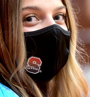 Susquehannock Senior Class President Allie Abel sports the Warrior mask during commencement exercises at the school Thursday, May 27, 2021. The school graduated 225 students. Bill Kalina photo