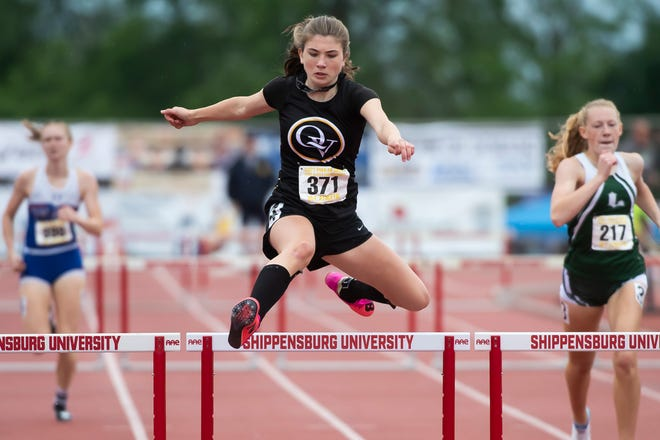 Quaker Valley's Nora Johns clears the final hurdle on her way to a gold medal in the 2A girls' 300m hurdles at the PIAA track and field championships at Shippensburg University on Friday, May 28, 2021. Johns won in 45.07.