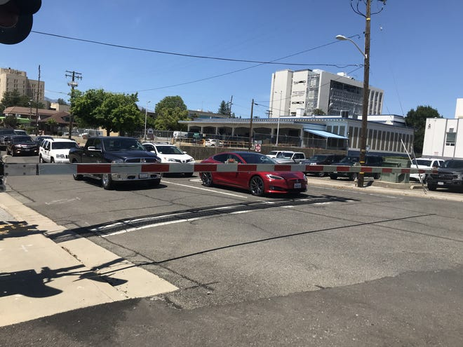 Cars are stopped at a railroad crossing in downtown Redding on Friday, May 28, 2021.