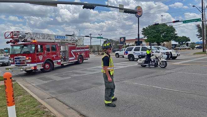 Members of the San Angelo Fire and Police Departments work a scene where a vehicle struck a pedestrian at the intersection of Knickerbocker Rd. and Parkview Dr. on Friday, May 28, 2021.