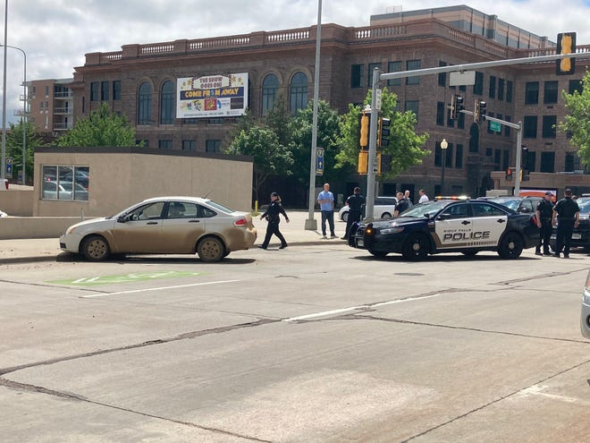 A vehicle crashed into a downtown parking meter on South Dakota Avenue after leading police on a chase throughout Sioux Falls on May 28, 2021.