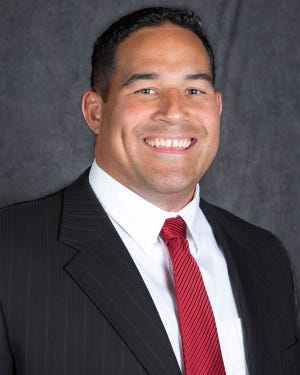 Justin Ena, Dixie State University football defensive coordinator.