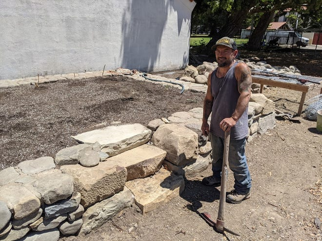 Vincent Amorosino, a local artist and stone mason based at Lindhard's Ventura sculpture center Art City Studios, formed large, raised beds from piles of boulders on the site at the Museum of Ventura County.