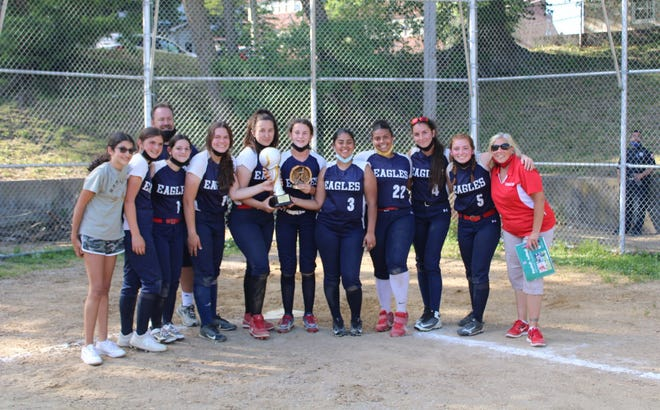 The Yonkers Montessori Eagles celebrate with the Yonkers City tournament trophy, after defeating Yonkers, 20-5, in the finals.