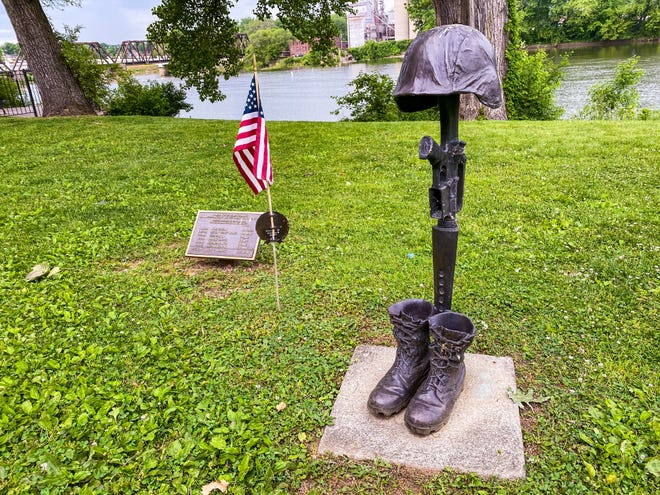 Members of the Tri-County Gold Star Families group established a memorial at Zane's Landing Park to honor the men who died in Iraq.