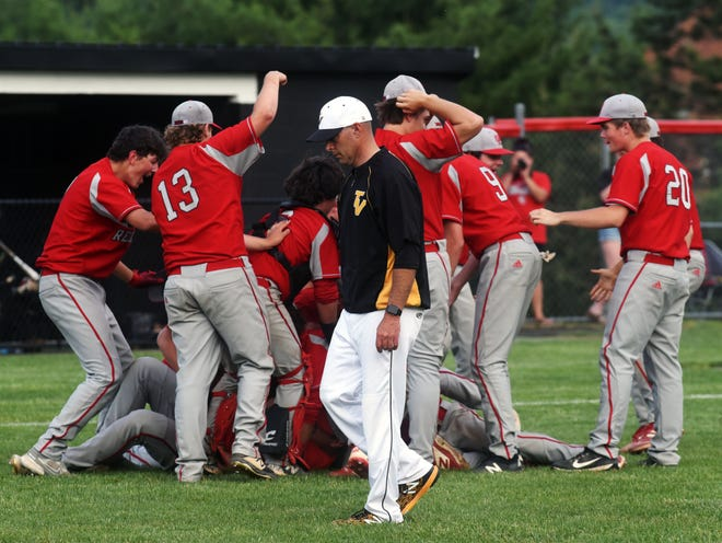 Tri-Valley coach Kevin Yoder walks off the field as St. Clairsville celebrates a 10-5 win in a Division II district final on May 27 at Muskingum's Mose Morehead Field.