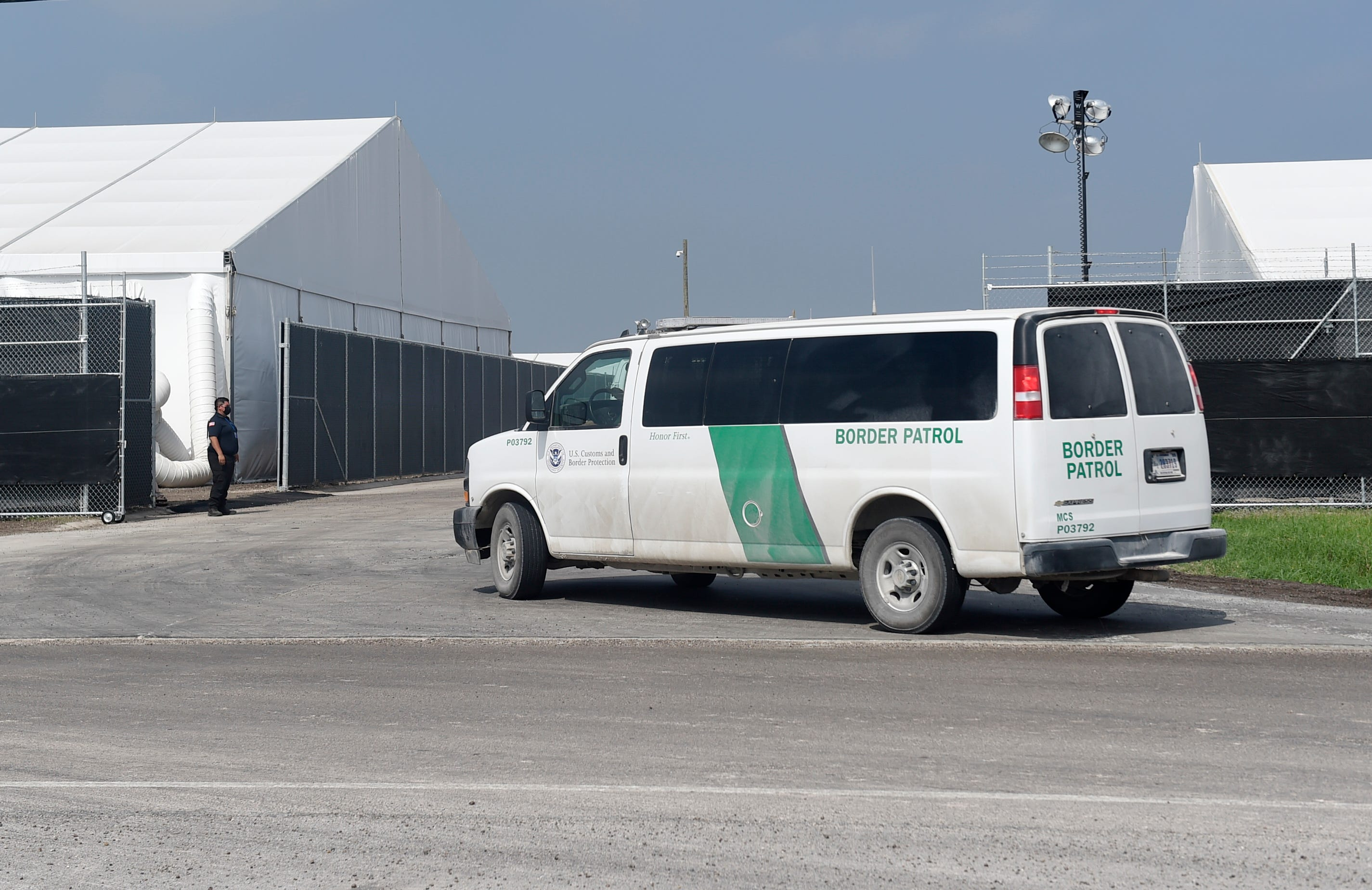 A Border Patrol van pulls into a U.S. Customs and Border Protection temporary processing center April 9 in Donna, Texas. The center was built to increase capacity for incoming migrants along the Rio Grande Valley sector.