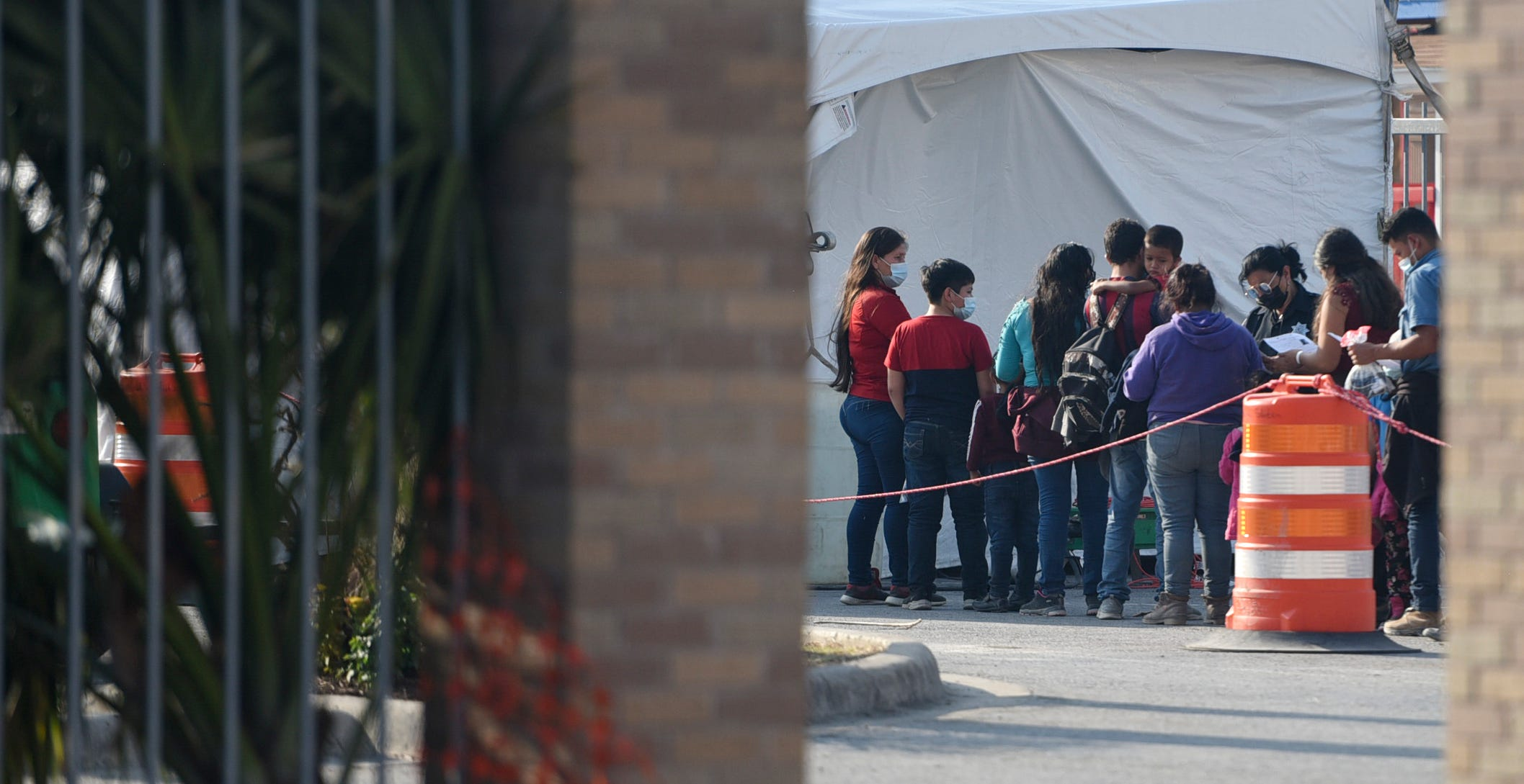 Migrants check in to be tested for the coronavirus April 9 in McAllen, Texas. The temporary tents are used to test all migrants before they travel to their asylum sponsors.