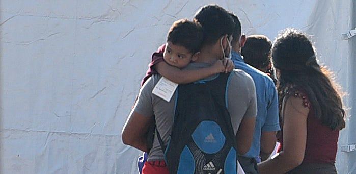 Migrants await coronavirus tests April 9 in McAllen, Texas.