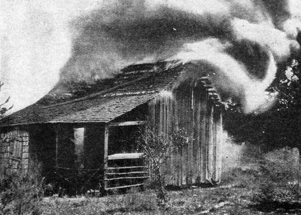 Deliberate burning of an African American home in Rosewood, Florida, on January 4, 1923.