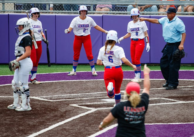 Leander's Marley Neises steps on home plate during the seventh inning against the Georgetown Eagles in the first game of a Class 5A Region IV championship series Friday at Concordia University. Leander, the No. 1 team in the state, won 10-5.