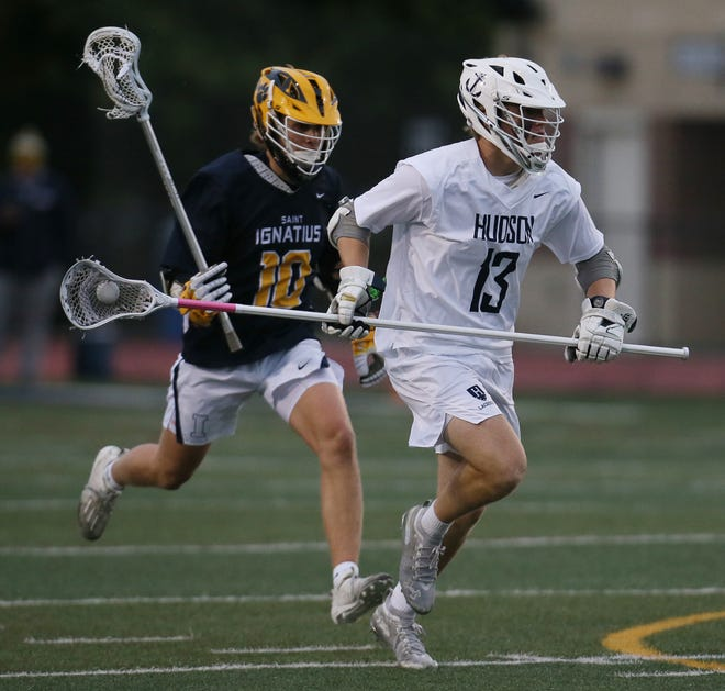 Hudson Griffin Liedel runs with the ball as St. Ignatius Ken Lubnik pursues in the first quarter of the Division I regional final lacrosse game at Hudson Memorial Stadium on Friday May 28, 2021 in Hudson. Hudson lost to St. Ignatius  6 t0 8.
