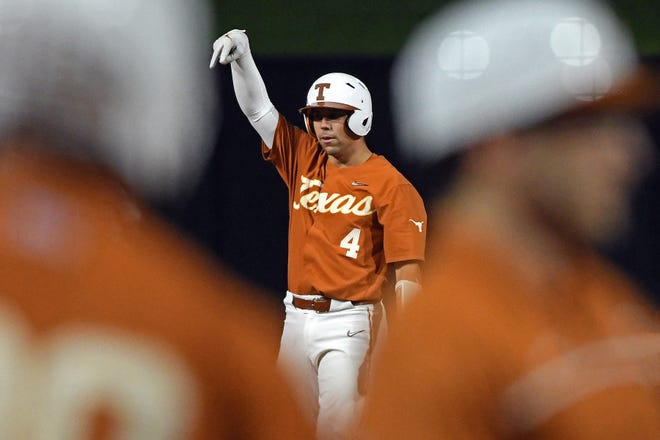 Texas catcher Silas Ardoin celebrates a two-run double against West Virginia at Chickasaw Bricktown Ballpark in Oklahoma City on Friday. Ardoin's hit plated the winning runs in a 3-2 victory for No. 2 Texas.