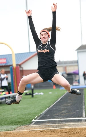 Marlington's Ariana Painter in the girls long jump during the DII Regional Track Championships at Austintown High School Saturday, May 29, 2021.