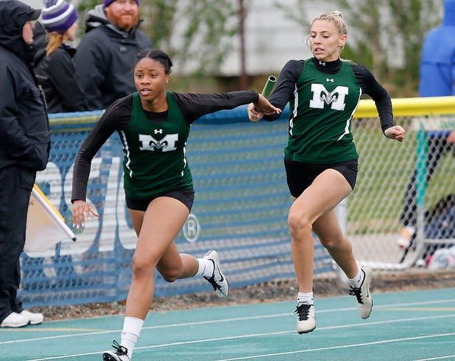 Madison High School's Kari Eckenwiler hands off to Alexsia Davis as they compete in the 4x200 meter relay at the OHSAA Division I Region 2 track meet Friday, May 28, 2021 at Amherst Steele High School. TOM E. PUSKAR/TIMES-GAZETTE.COM