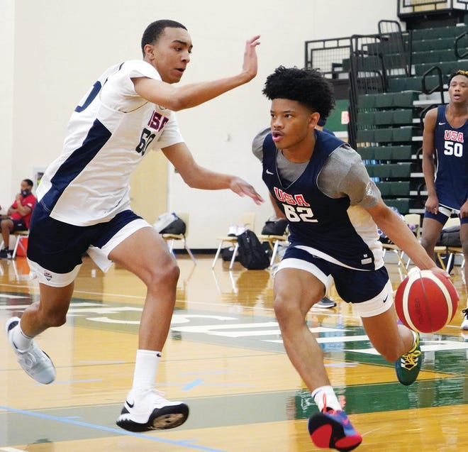 ON THE BIG STAGE: Bartlesville's David Castillo, right, drives with full determination against an opponent during the USA Basketball 16U Minicamp this week in Houston, Texas. Castillo is heading into his sophomore season at Bartlesville High.